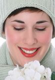 Smiling Female Eyes Closed with White Flowers Stock Image