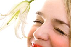 Smiling female face close-up with lily stock images