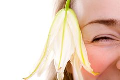 Smiling female face with lily Stock Images