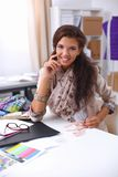 Smiling female fashion designer sitting at office Royalty Free Stock Photography