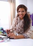 Smiling female fashion designer sitting at office Stock Images