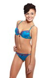 Smiling female fashion model in blue lingerie Royalty Free Stock Photo