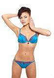 Smiling female fashion model in blue lingerie Royalty Free Stock Images