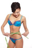 Smiling female fashion model in blue lingerie Stock Photos