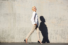 Smiling female fashion model walking Royalty Free Stock Photo