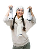 Smiling female figure skater keeps skates. Smiling female figure skater holds skates, isolated on white Stock Images