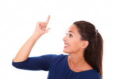 Smiling female with finger pointing up royalty free stock photo