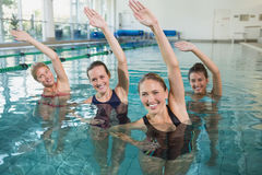 Smiling female fitness class doing aqua aerobics. In swimming pool at the leisure centre stock photos