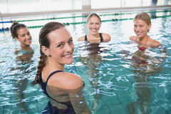 Smiling female fitness class doing aqua aerobics Stock Photos