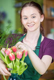 Smiling Female Florist Creating Tulip Arrangement Royalty Free Stock Images