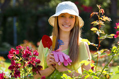 Smiling female florists in apron working Stock Images