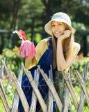 Smiling female gardener in uniform Royalty Free Stock Photos