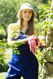 Smiling female gardener in uniform Royalty Free Stock Images