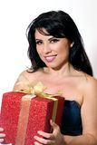 Smiling female with gift box tied with gold ribbon Royalty Free Stock Images