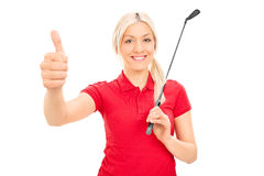 Smiling female golfer giving thumb up. Isolated on white background Royalty Free Stock Photography