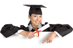 Smiling female graduate holding a sign with diploma Royalty Free Stock Images