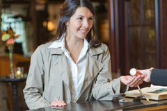 Smiling female guest in a hotel lobby Stock Image