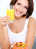 Smiling female has lunch from vegetables Royalty Free Stock Photo