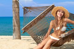Smiling female with a hat on beautiful beach Royalty Free Stock Images
