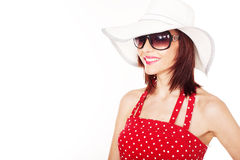Smiling female with hat and sunglasses Stock Images