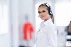 Smiling female helpline operator with headphones Stock Photos