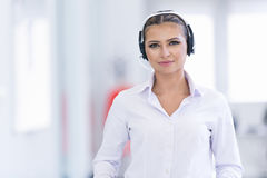 Smiling female helpline operator with headphones Stock Photography