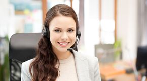 Smiling female helpline operator with headset Royalty Free Stock Photo