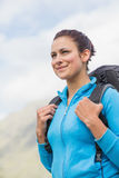Smiling female hiker with backpack Stock Photo