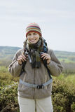 Smiling Female Hiker In Countryside Royalty Free Stock Image