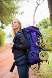 Smiling female hiker waiting by the side of the road Stock Photos