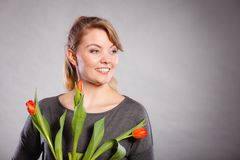 Smiling female holding boquet. Celebration gift present flora nature beauty concept. Smiling female holding boquet. Young lady showing tulip flowers stock images