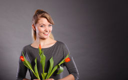 Smiling female holding boquet. Celebration gift present flora nature beauty concept. Smiling female holding boquet. Young lady showing tulip flowers stock photography