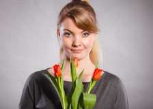 Smiling female holding boquet. Celebration gift present flora nature beauty concept. Smiling female holding boquet. Young lady showing tulip flowers royalty free stock image