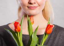 Smiling female holding boquet. Celebration gift present flora nature beauty concept. Smiling female holding boquet. Young lady showing tulip flowers royalty free stock images