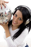 Smiling female holding disco mirror ball Royalty Free Stock Photos
