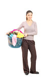 Smiling female holding a laundry basket Stock Photography
