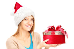 Smiling female with holding a present Royalty Free Stock Images
