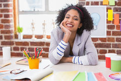 Smiling female interior designer at desk Stock Photo