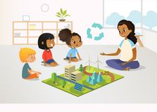 Smiling female kindergarten teacher and children sit on floor and explore toy model with renewable or sustainable energy. Systems, wind and solar eco friendly vector illustration