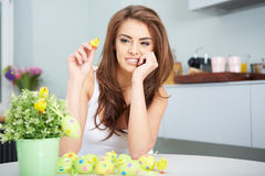 Smiling female laughing with colorful easter eggs Stock Photos