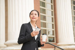 Smiling female lawyer holding coffee paper cup Royalty Free Stock Images
