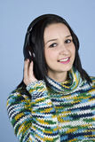Smiling female listening music Royalty Free Stock Photo