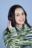 Smiling female listening music royalty free stock photo