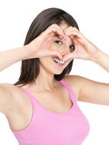 Smiling female in love forming heart with hands Stock Photo