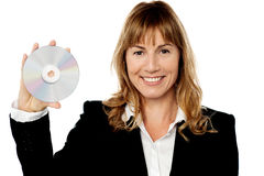 Smiling female manager showing compact disc Royalty Free Stock Photography