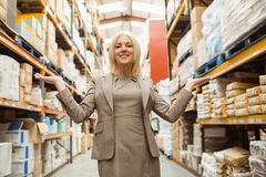 Smiling female manager showing with her hands Stock Photos