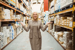 Smiling female manager showing with her hands Stock Photography