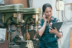 Smiling female milling machine factory manager stock photos