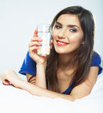 Smiling female model portrait with water glass. Stock Photos