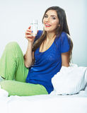 Smiling female model portrait with water glass. Stock Image